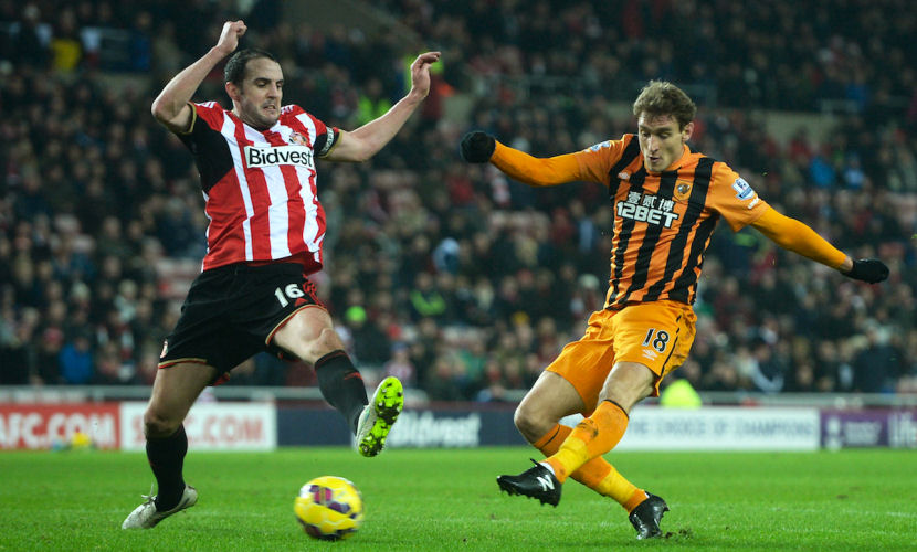 SUNDERLAND, ENGLAND - DECEMBER 26: Nikica Jelevic of Hull City scores his team's third goal despite the efforts of John O'Shea of Sunderland during the Barclays Premier League match between Sunderland and Hull City at the Stadium of Light on December 26, 2014 in Sunderland, England. (Photo by Nigel Roddis/Getty Images)